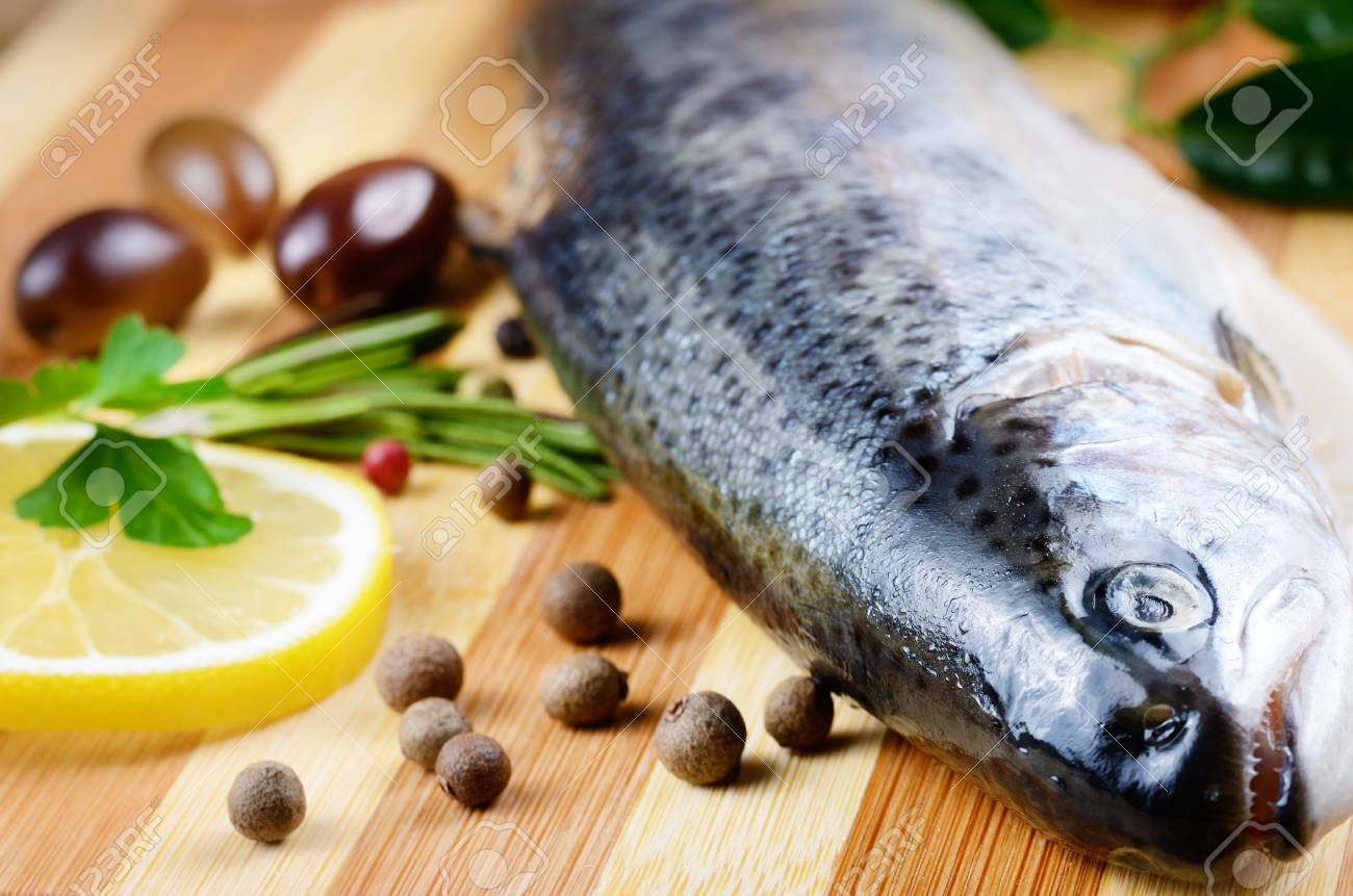 Raw trout on the chopping board with lemon and spices Stock Photo - 19628907
