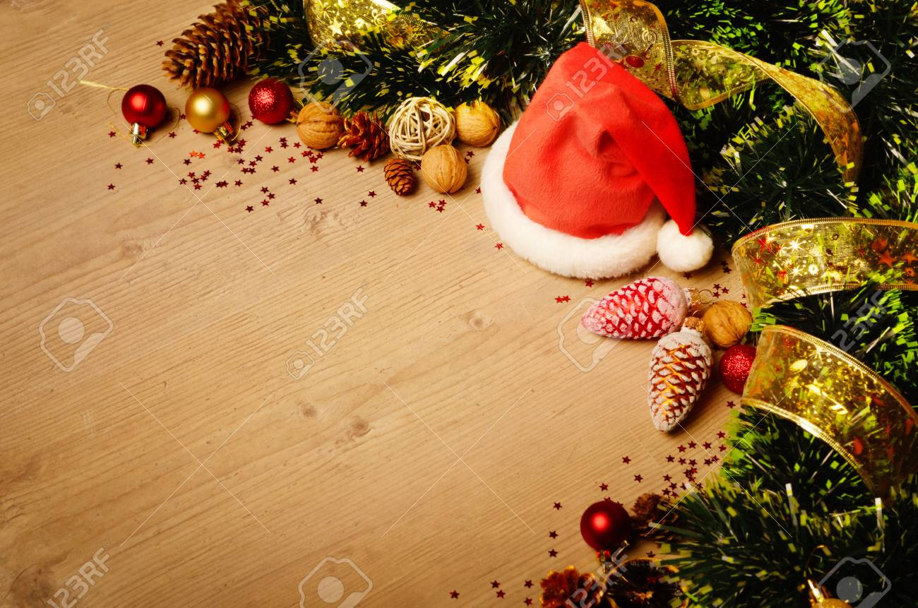 new year theme decorations with santa hat on wooden table stock photo 83873608
