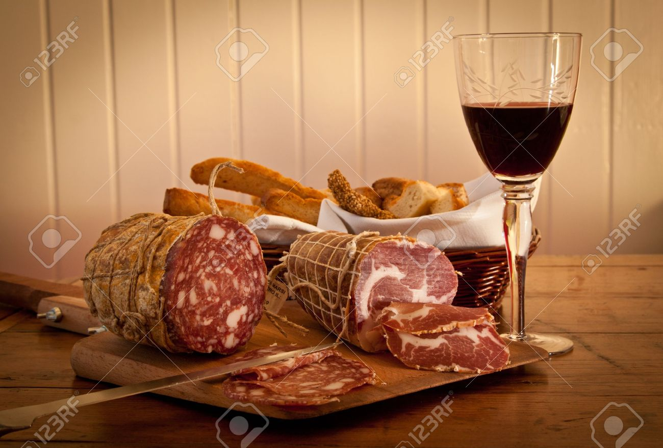 Delicious Mediterranean snack: red wine with salami and home-made bread. - 13868346