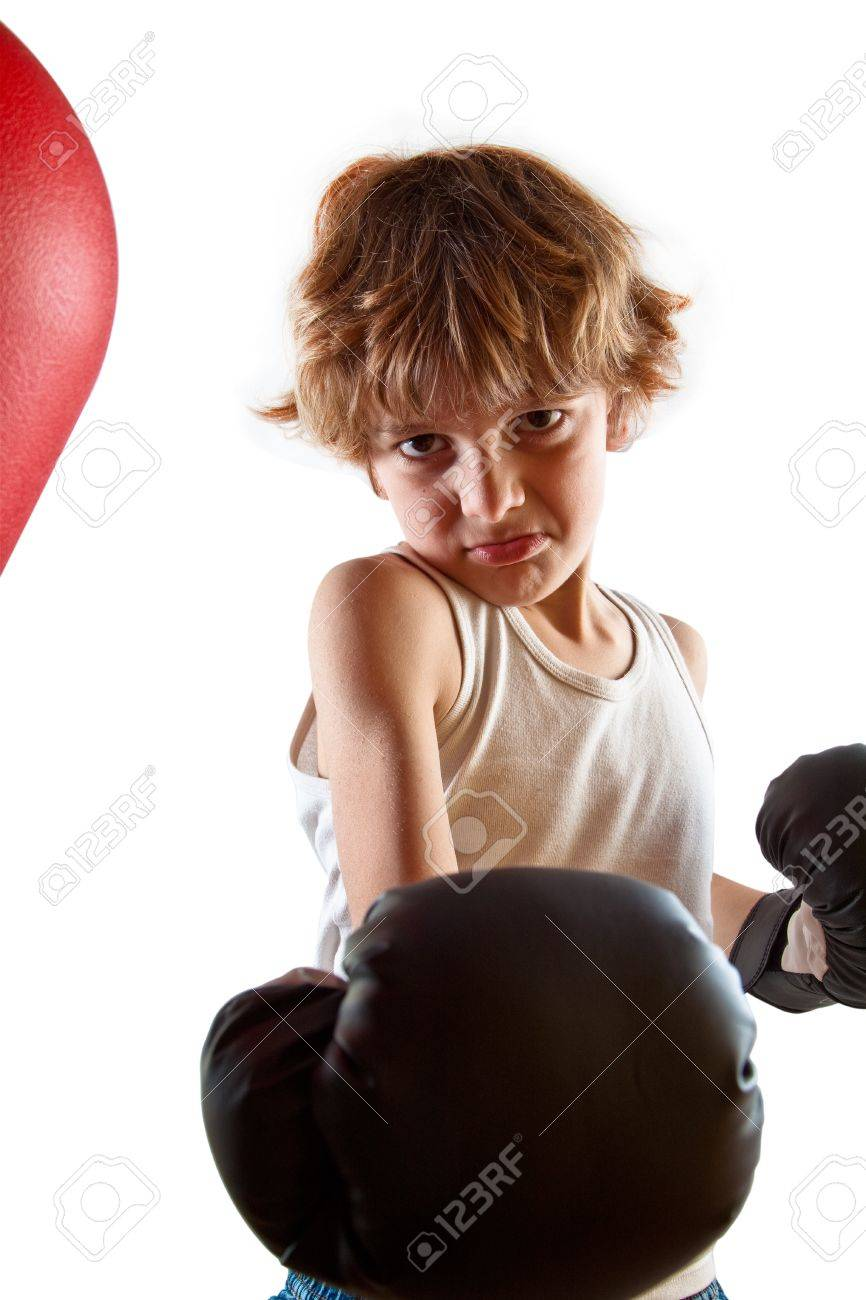 Kid with attitude during boxing training with punching ball. Stock Photo - 13897361