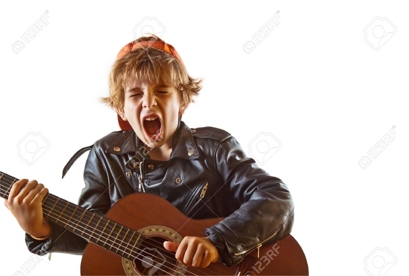 Cute small kid playing guitar with great concentration and attitude. White background, plenty of copyspace. - 13896832