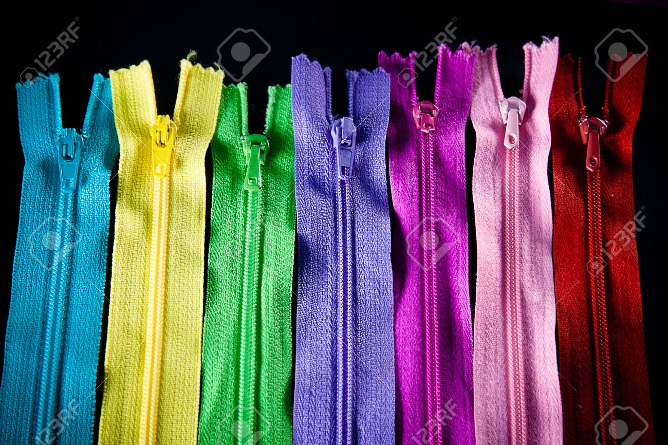 Colourful zips in rainbow colours. - 13899038