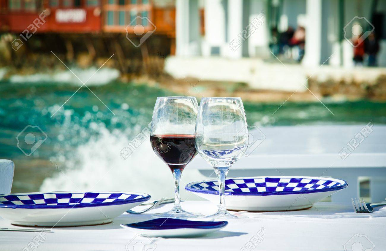 A table ready for a meal by the sea in Little Venice, Mykonos, Greece. - 13897256
