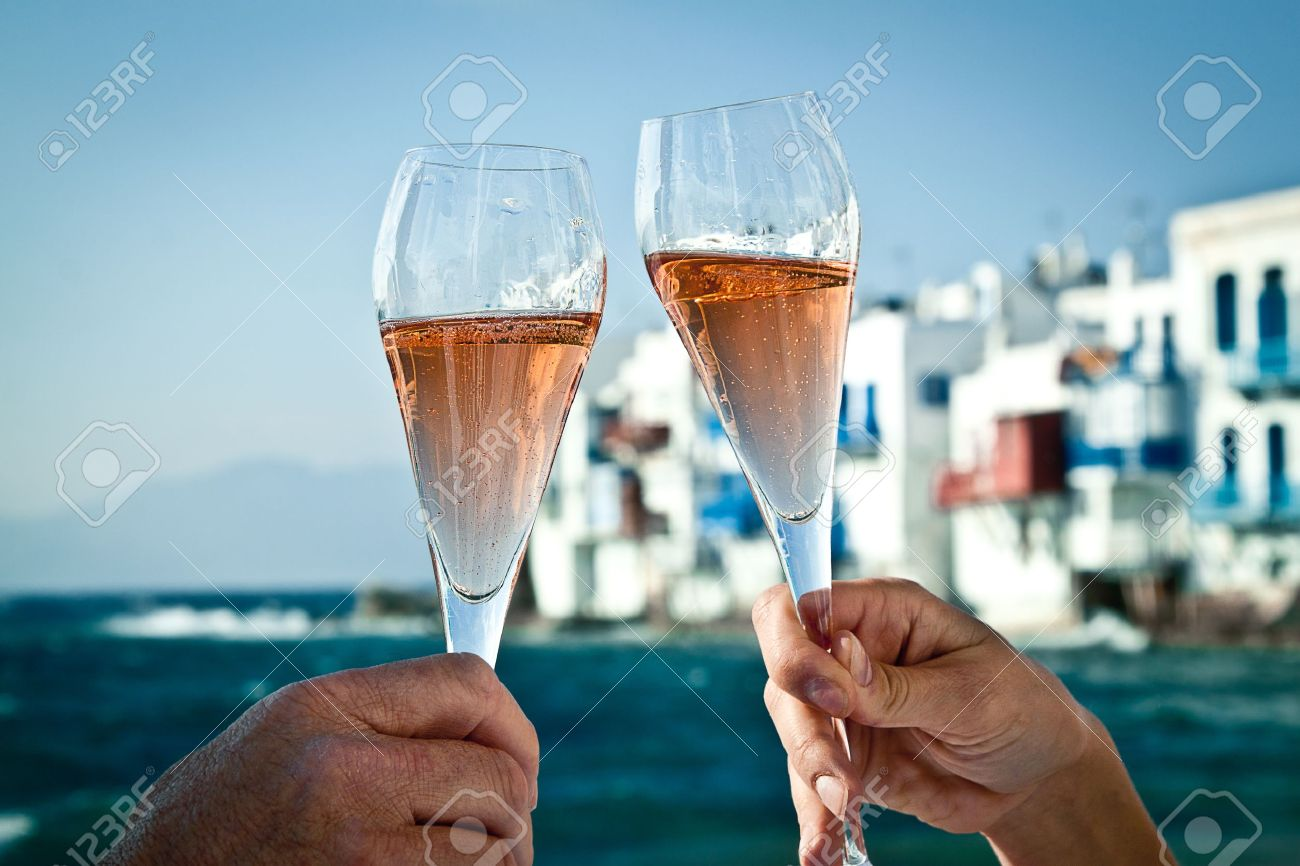 A romantic toast by the sea in Greece - 13897663