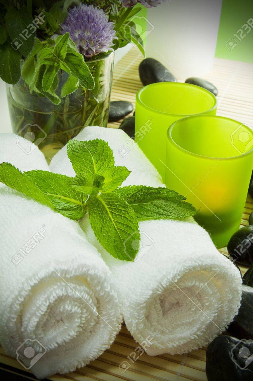 Warm towels, candles, herbs and zen stones for a spa treatment - 13898876