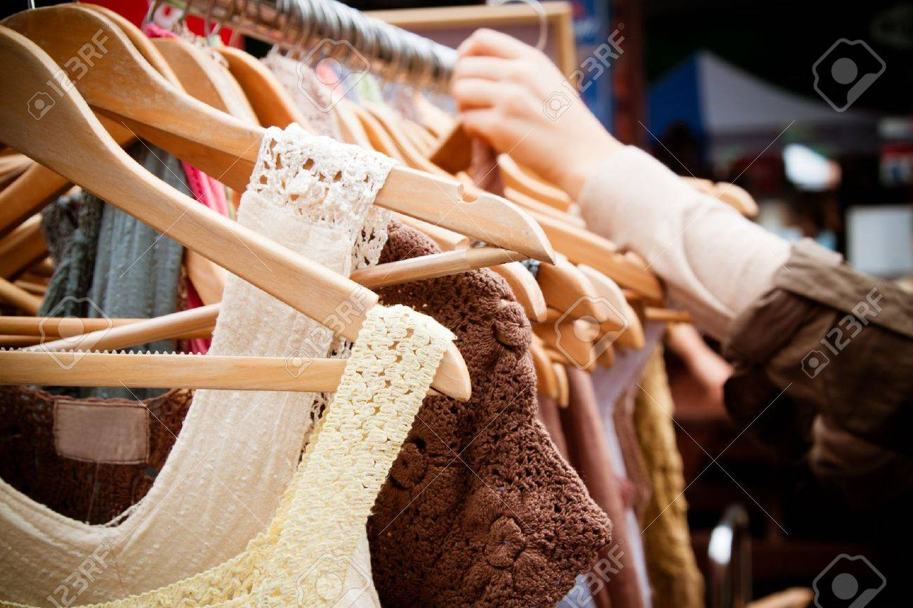 A rack of second-hand women dresses at a market in London  recession bargains Stock Photo - 13899112