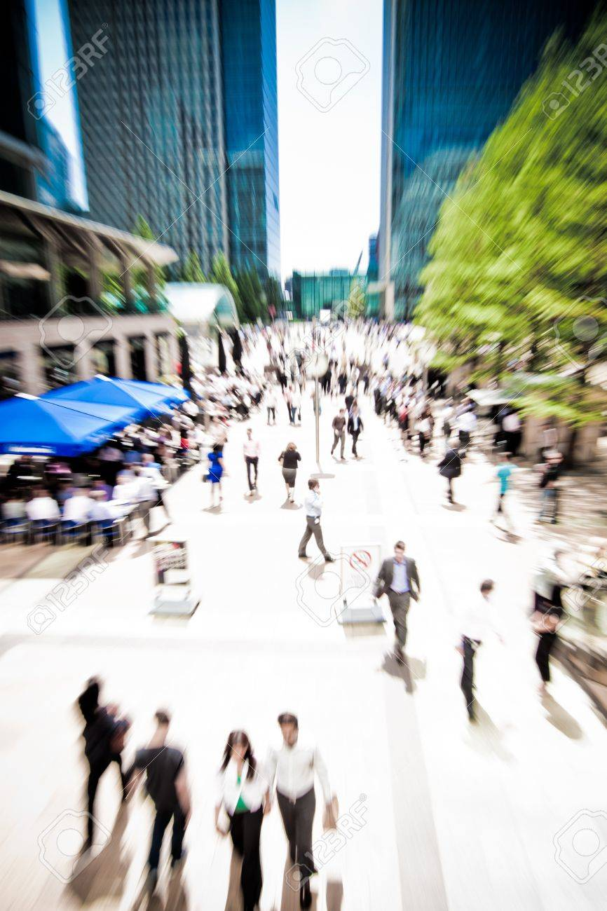 Zoom on business people rushing around at Canary Wharf, London  Motion blur Stock Photo - 13929349