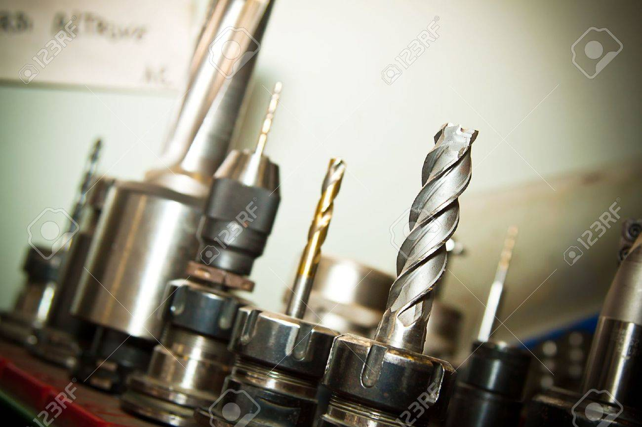 Detail of drilling machine bits in a high precision mechanics plant Stock Photo - 13955507