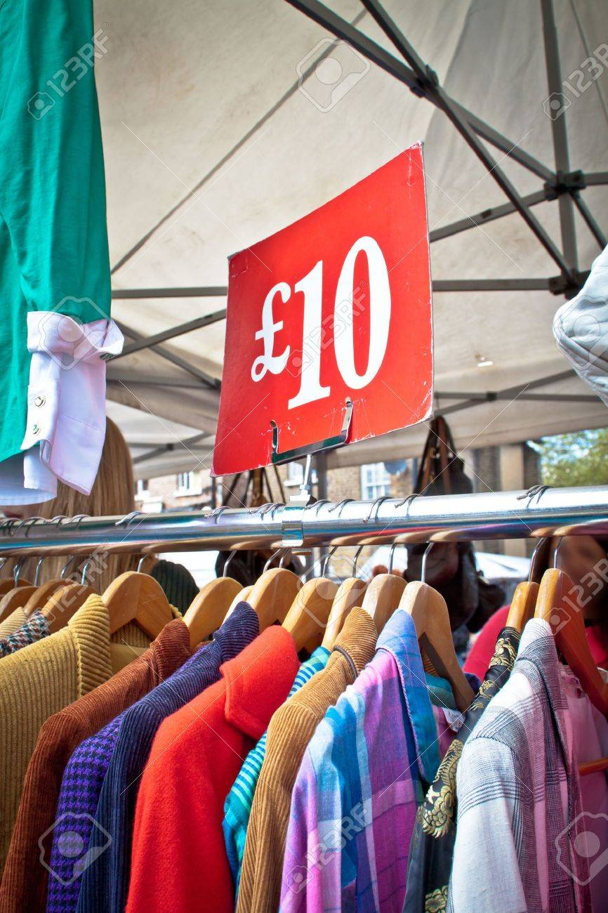 A bargain for a tenner. Second hand clothes rack at market. Portrait orientation. Stock Photo - 16529063