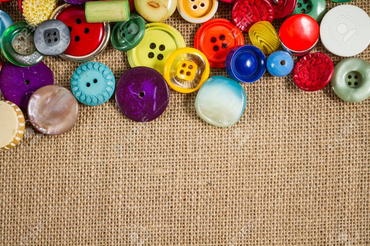 A great variety of colorful vintage buttons against a fabric background. Landscape orientation. Plenty of copy space. - 22441480