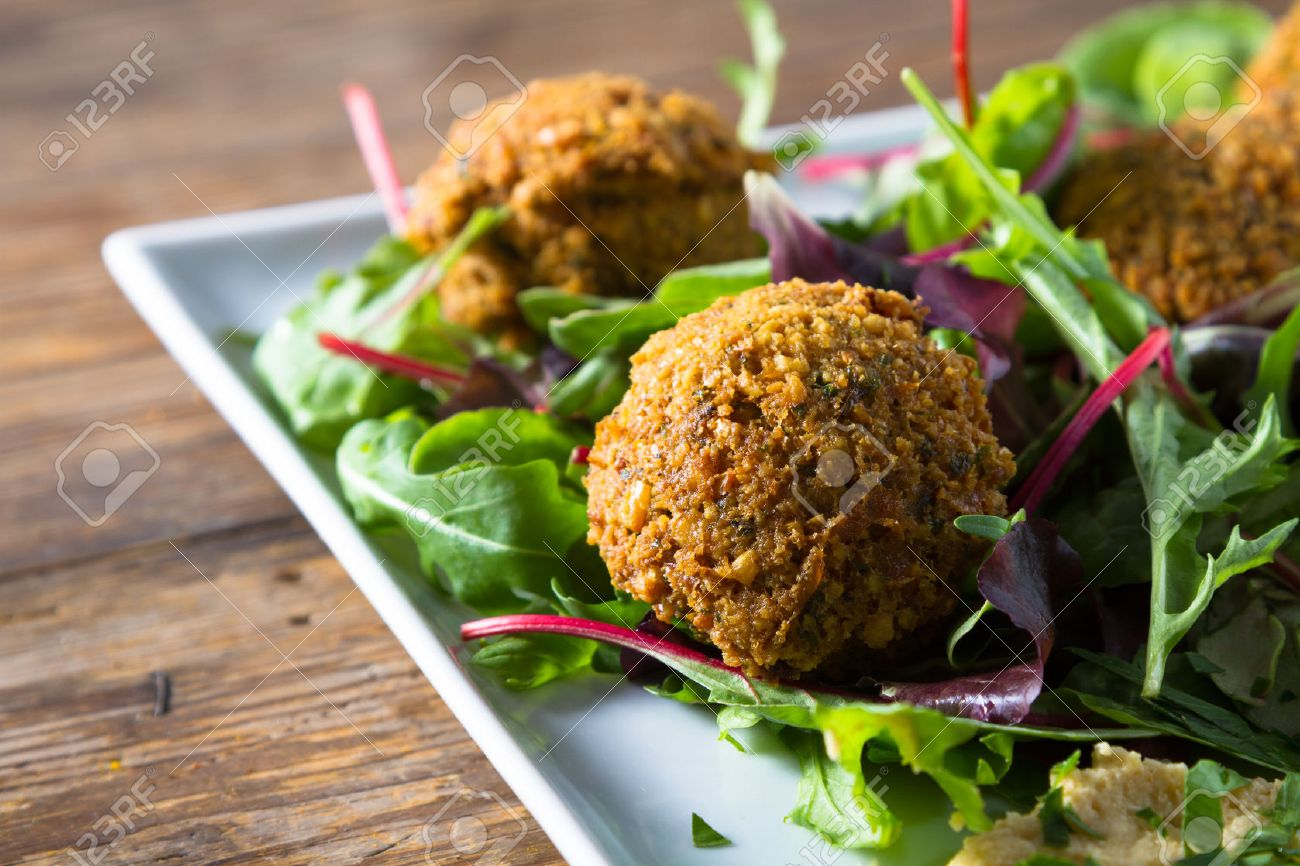 Middle East cuisine: a plate of delicious falafels and hummus. Vegetarian fare. - 22953543
