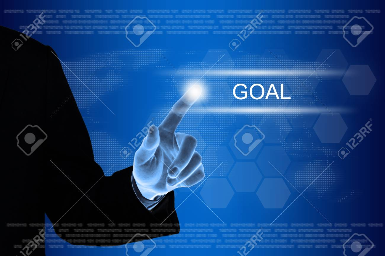 business hand pushing goal button on a touch screen interface Stock Photo - 26781643