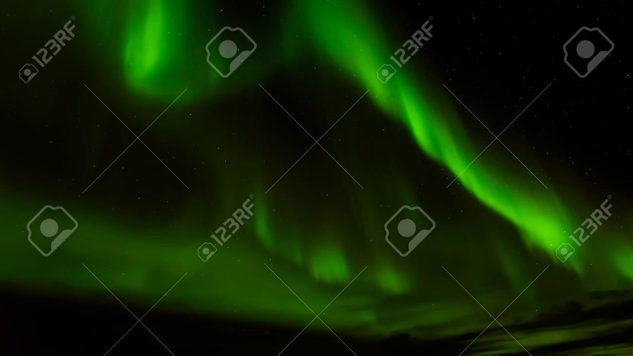 A Beautiful Green Aurora Borealis Or Northern Lights, Norway Stock Photo    74941002