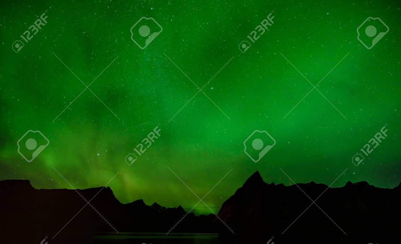 A Beautiful Green Aurora Borealis Or Northern Lights, Norway Stock Photo    94715665