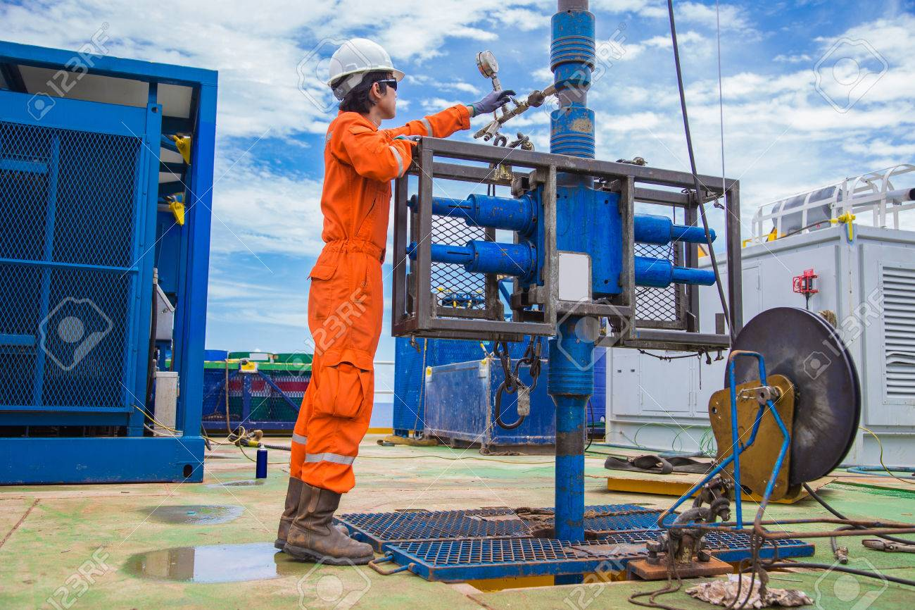 Offshore oil and gas industry, oil rig worker inspect and setting