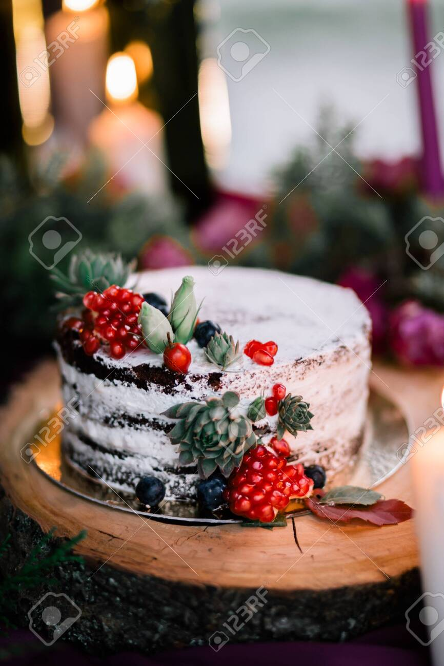 Delicate Wedding White Cake Decorated With Pomegranate And Succulent Stock Photo Picture And Royalty Free Image Image 127308113