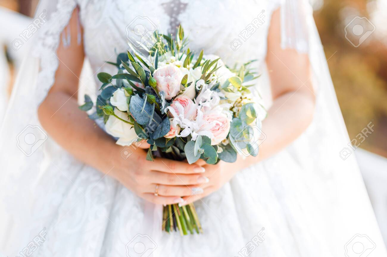 Delicate classic wedding bouquet of roses for the bride. Wedding flowers. - 134030078