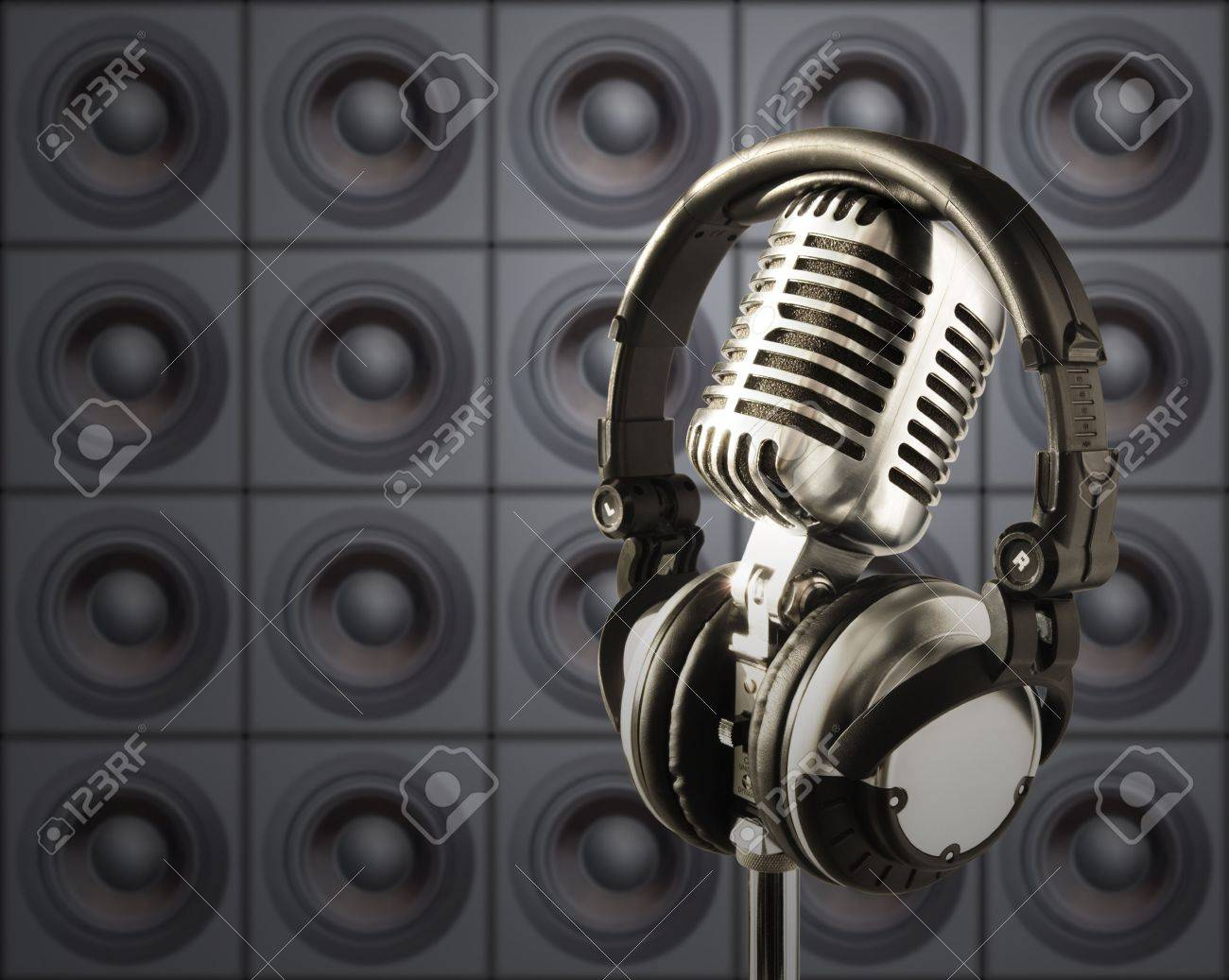 Professional 'Retro' Microphone & DJ Headphones In Spotlight Against The Wall Of Speakers Stock Photo - 633310