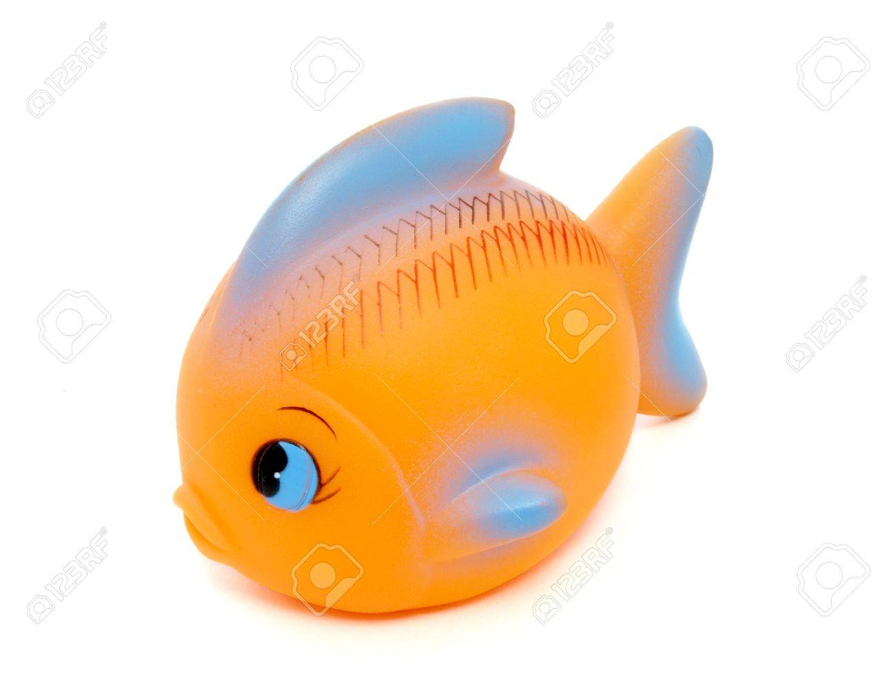 Close Up Of Orange Rubber Fish Toy On White Background With Path ...