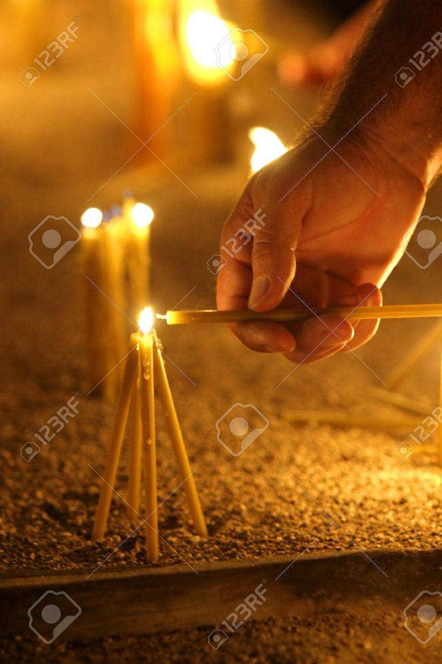 man hand lighting candles  in a church Stock Photo - 4344036