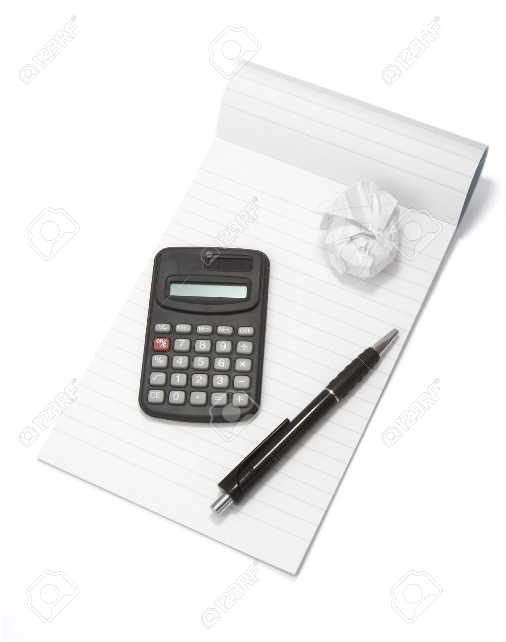 Close Up Of Notebook, Pencil, Calculator And Used Paper On White ...