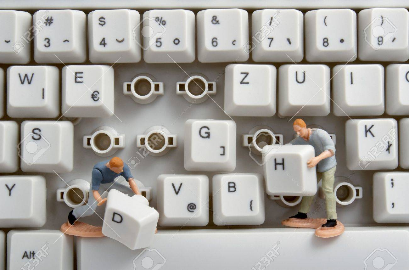 close up of computer keyboard and toy workers Stock Photo - 4456988