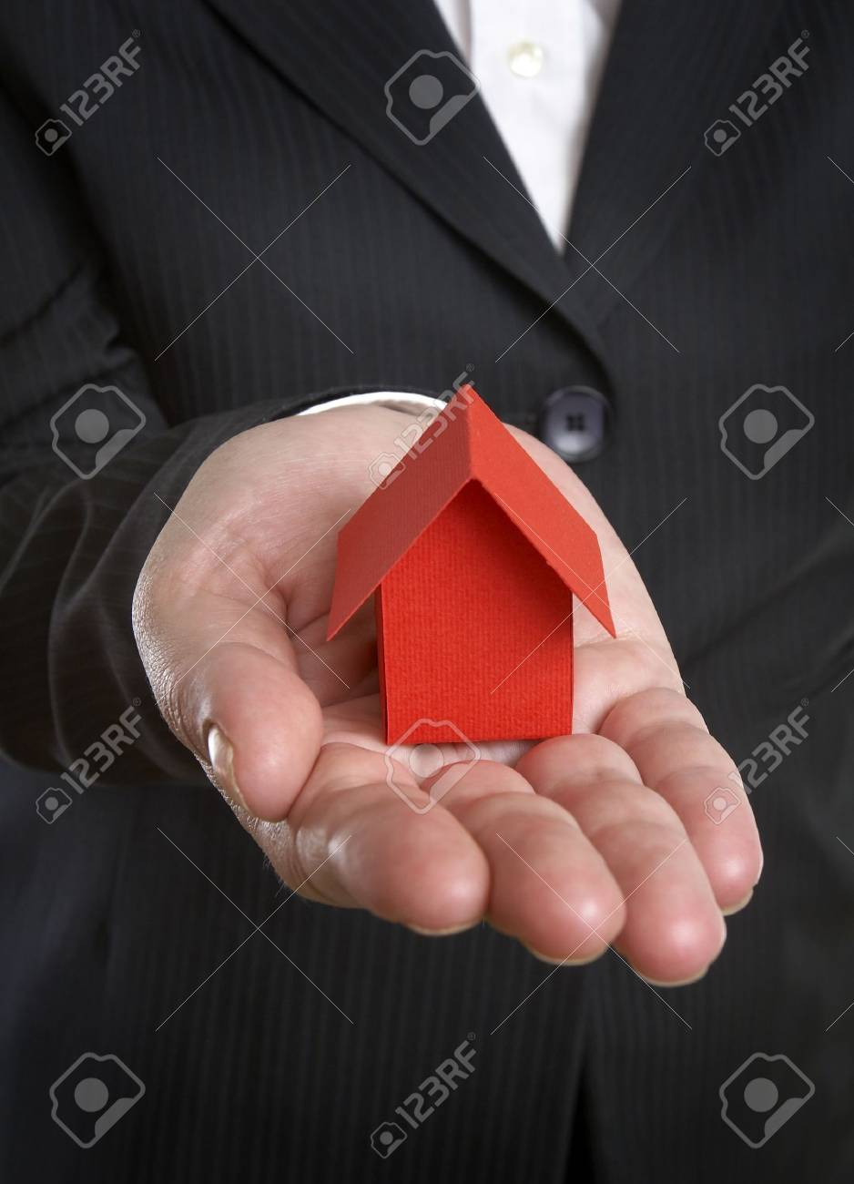 close up of businesswoman and miniature house Stock Photo - 4728109