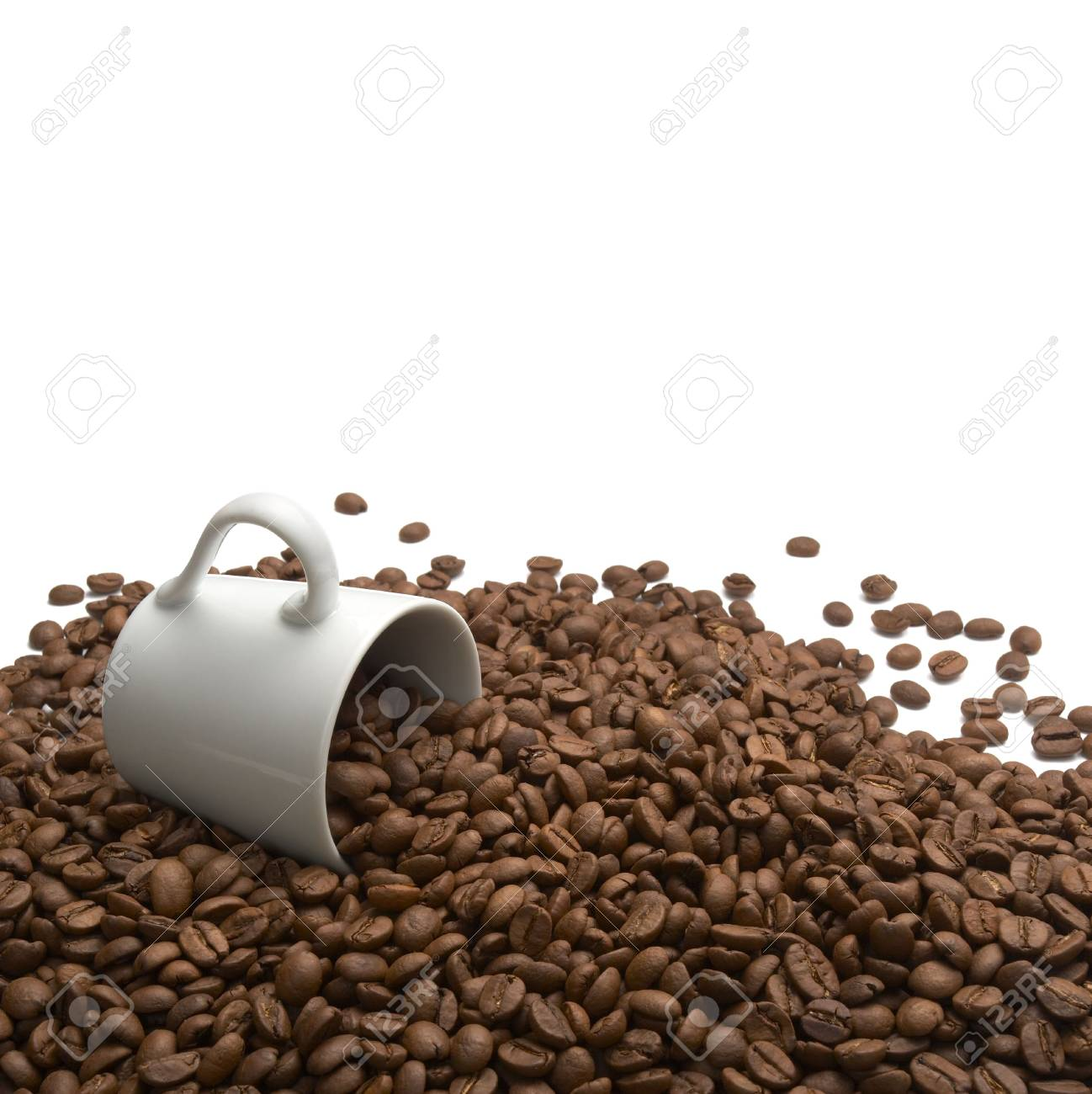 close up of coffee beans and coffee cup on white background Stock Photo - 4983577