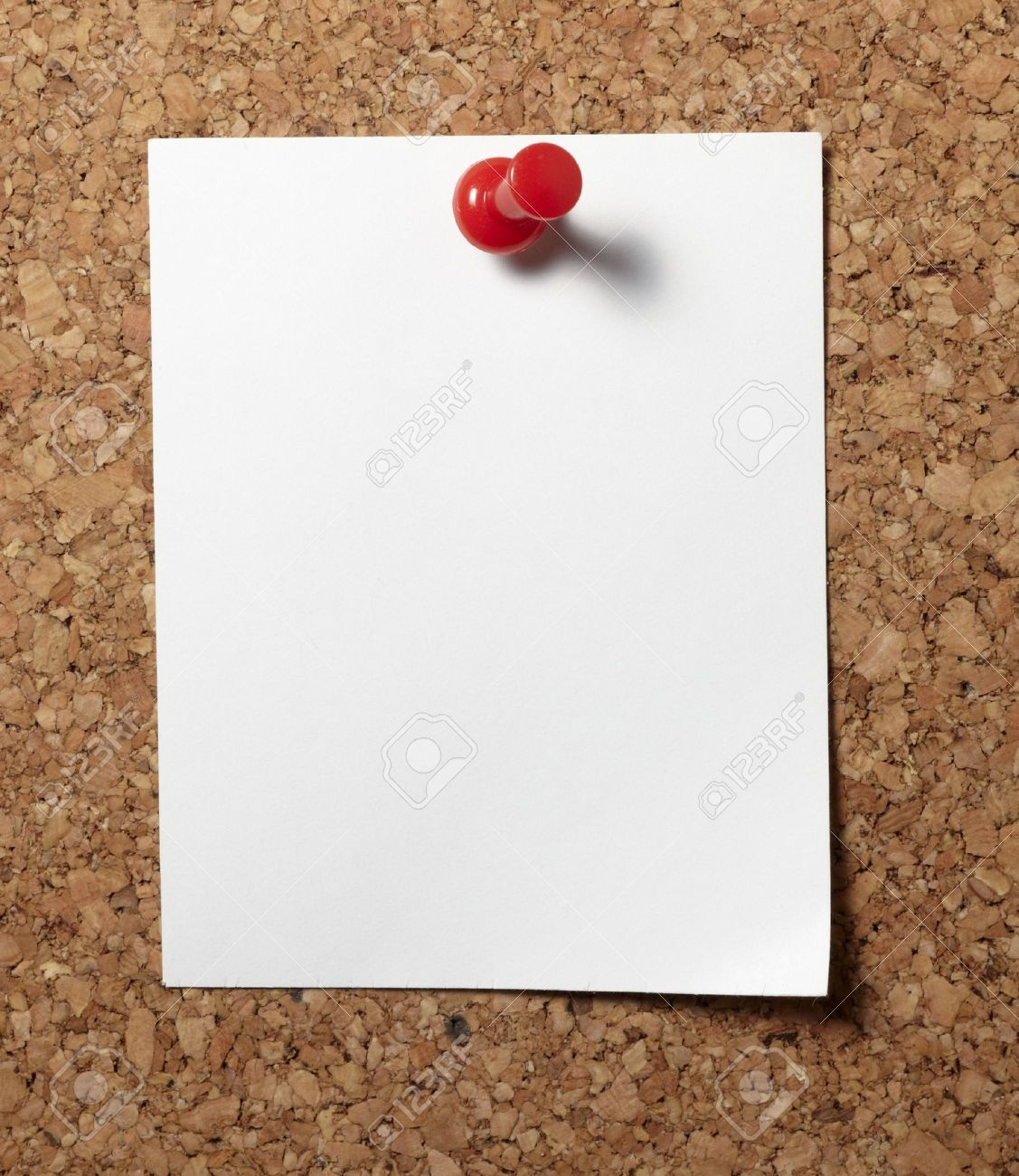 note paper with push pins on cork board stock photo