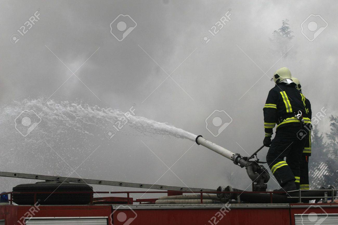 firefighters in action Stock Photo - 6353272