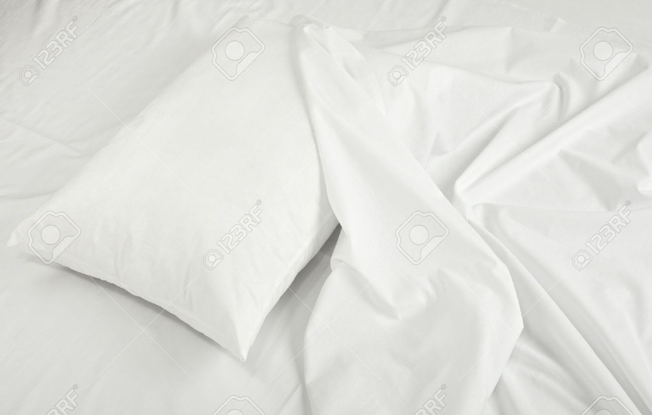 White bed pillows - Stock Photo Close Up Of Bedding Sheets And Pillow