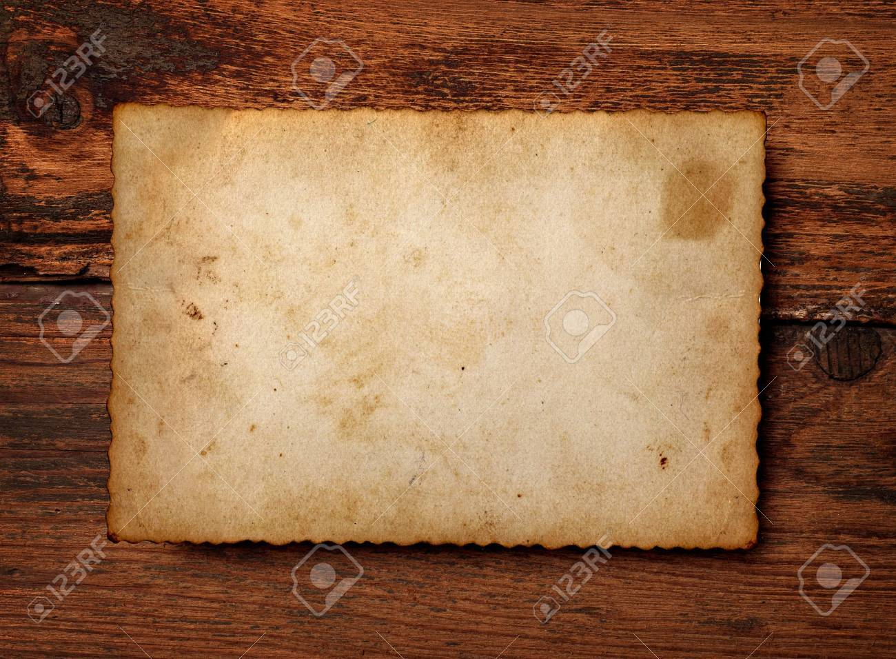 close up of an old photo on a wooden background Stock Photo - 14245919
