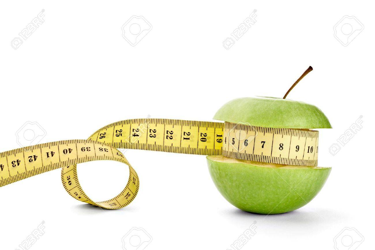 close up of  an apple measuring tape on white background with clipping path Stock Photo - 14359027