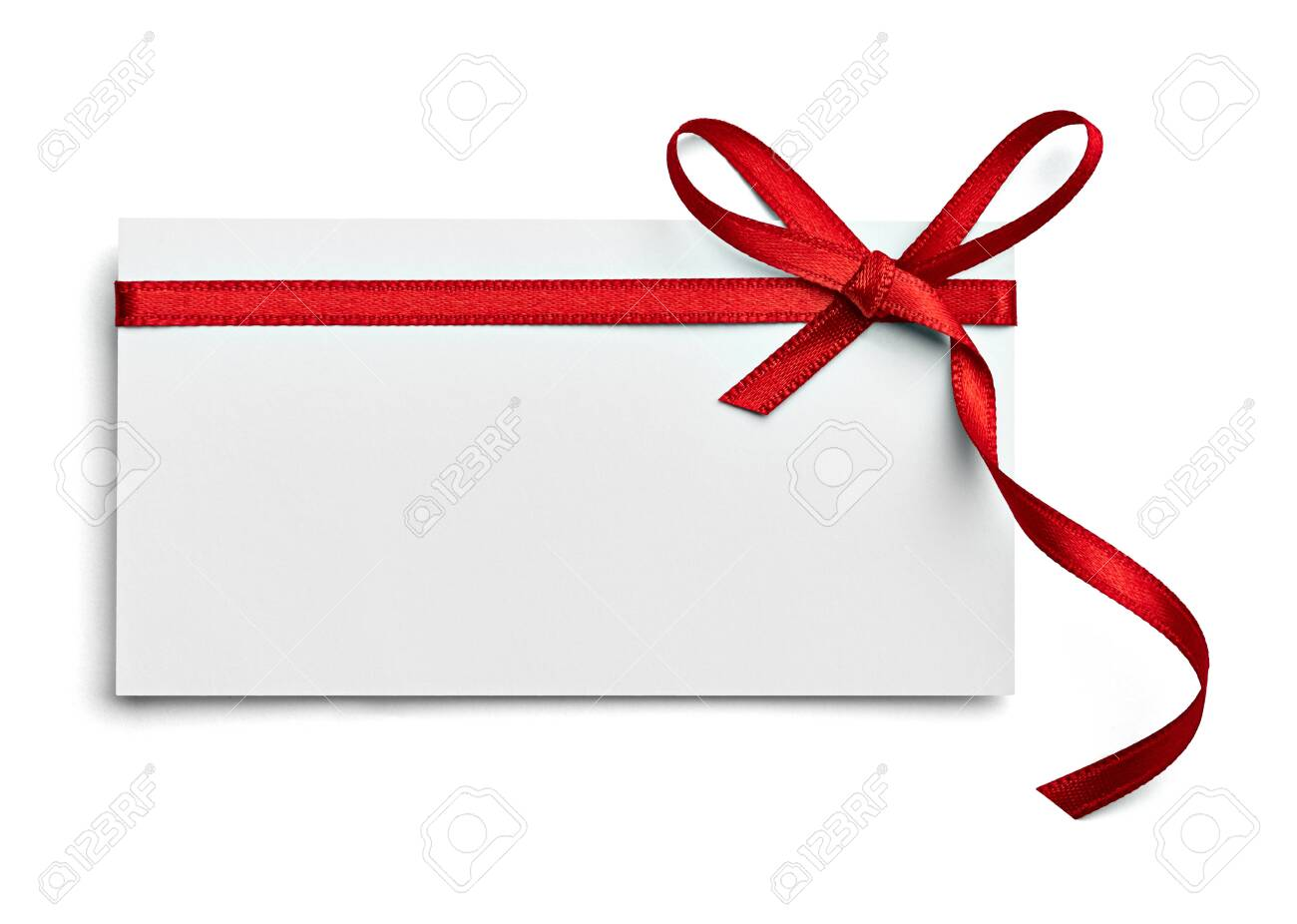 close up of a note card with red ribbon bow on white background - 124543995