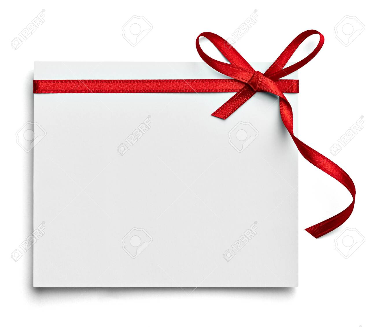 close up of a note card with red ribbon bow on white background - 140668030