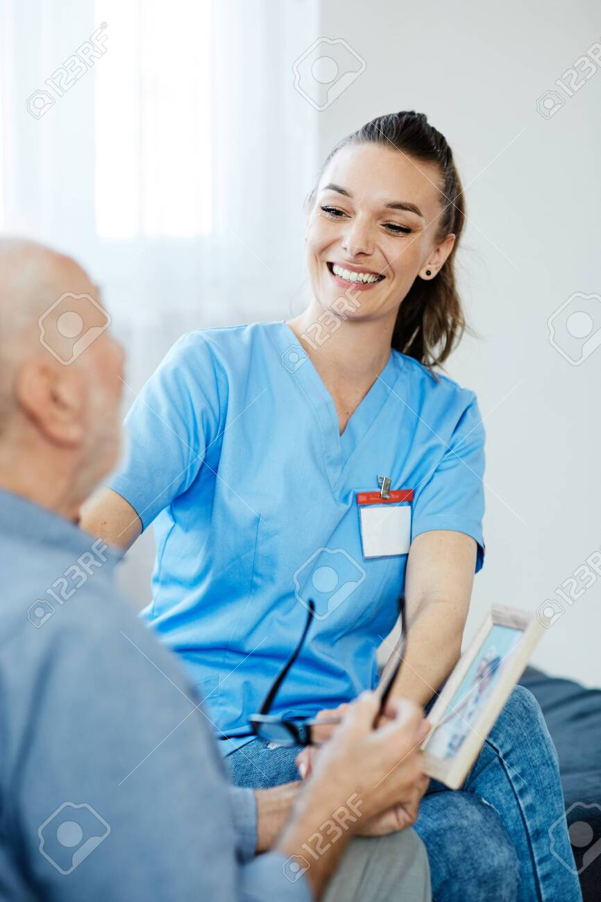 Doctor or nurse caregiver with senior man at home or nursing home - 145232686