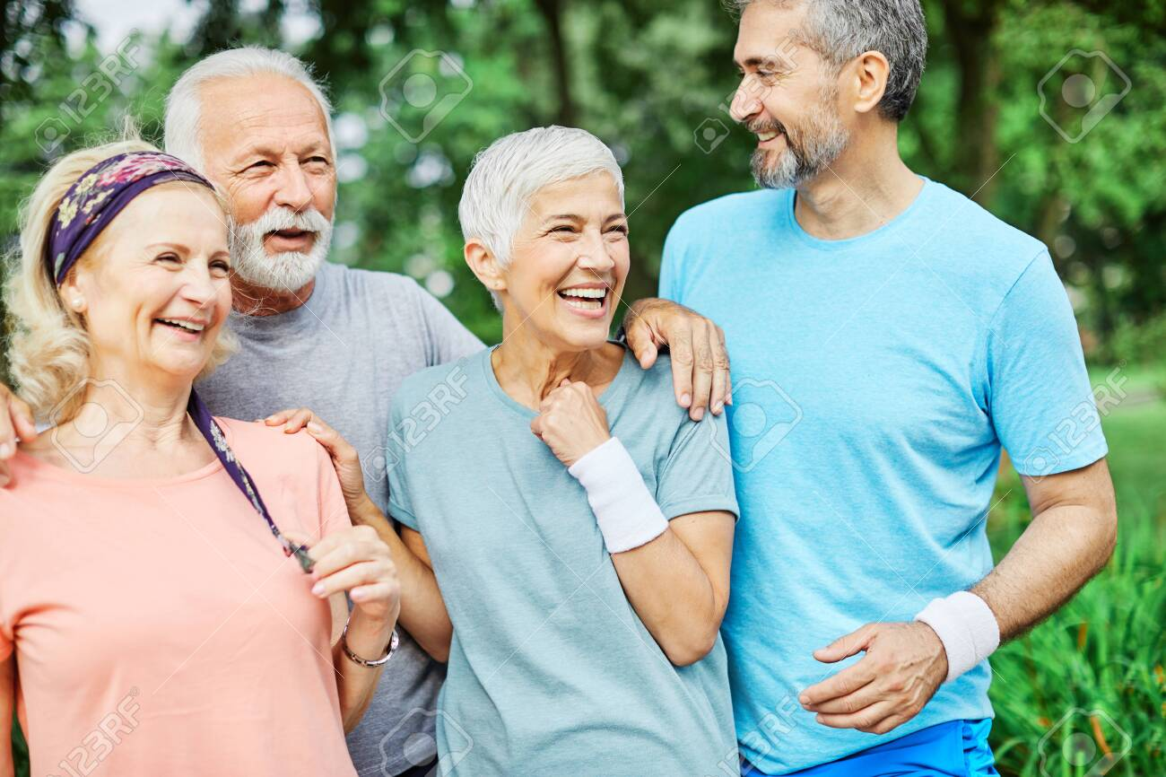 Smiling active senior people posing together in the park - 154533884