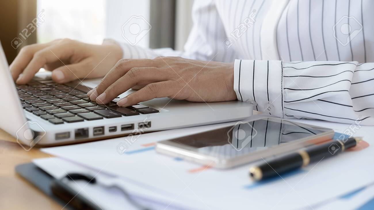 Business women using laptop to checking the company performance chart. Business concept. - 136739984
