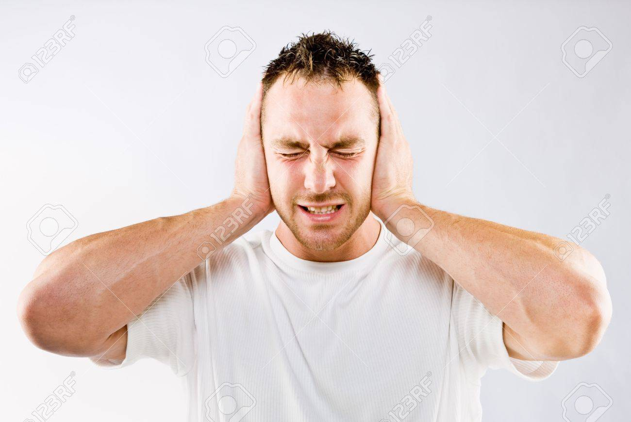6582281-man-blocking-out-loud-noise-from