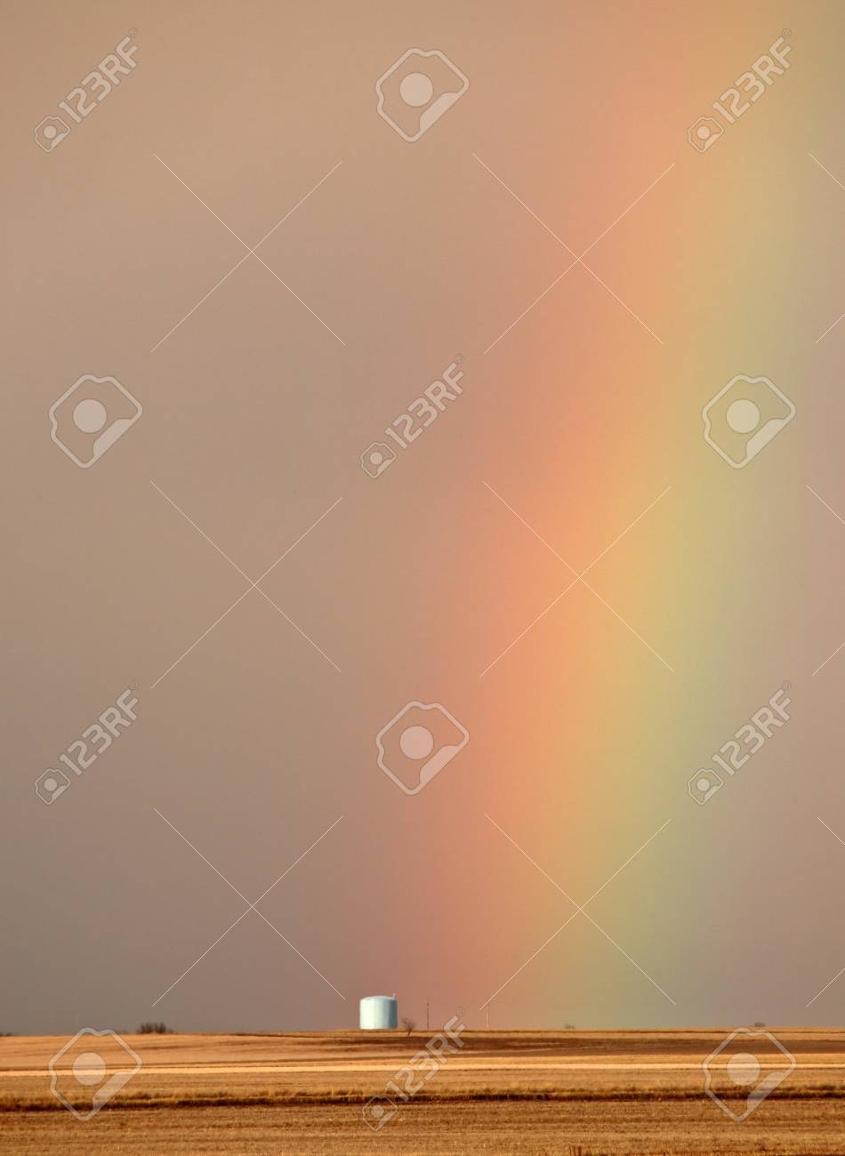 Rainbow behind silo in scenic Saskatchewan Stock Photo - 8441968