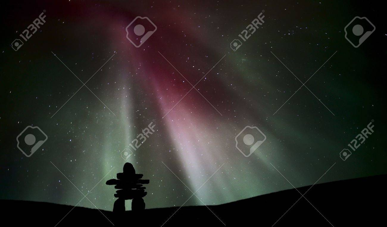 Northern light above an inukchuk in Saskatchewan Stock Photo - 8460492