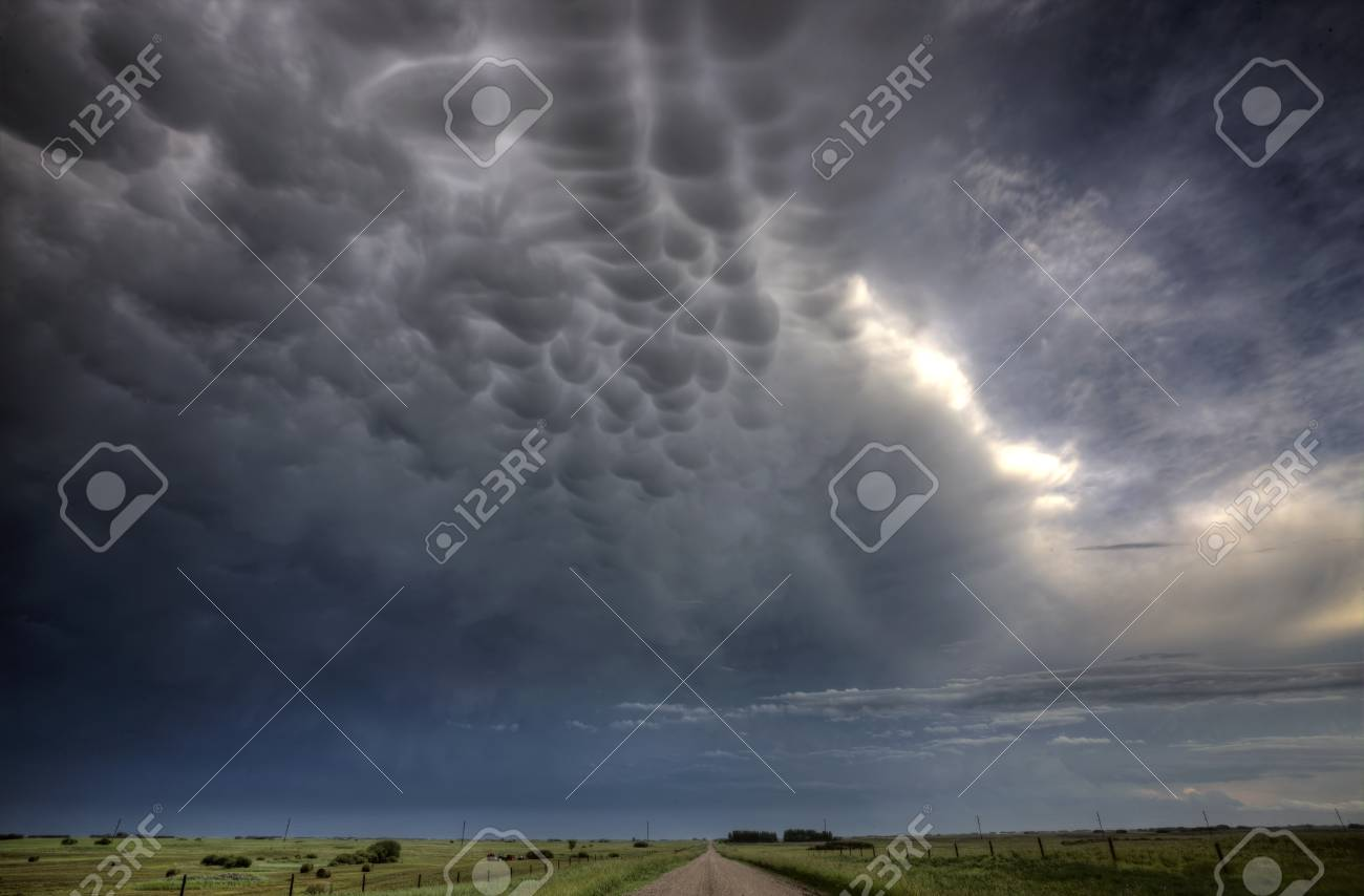 Storm Clouds Saskatchewan billowing clouds and gravel road Stock Photo - 16226487