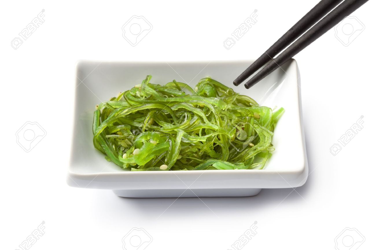 Dish with Japanese seaweed salad on white background Stock Photo - 9400544
