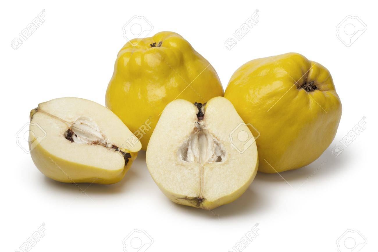 Fresh yellow whole and half Quinces on white background - 18223980