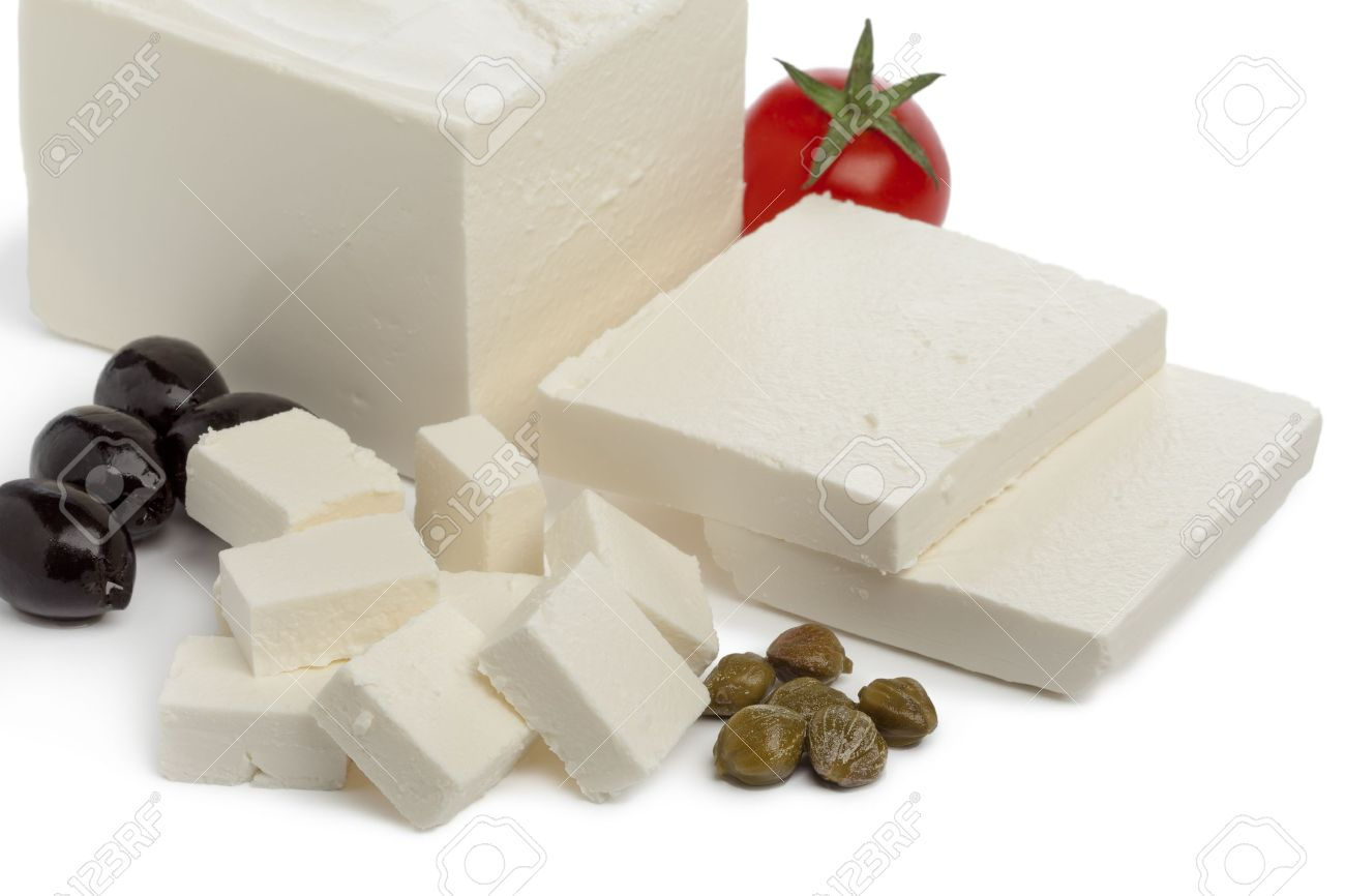 Fresh Feta cheese with slices and cubes, capers,tomato and black olives on white background - 18843449