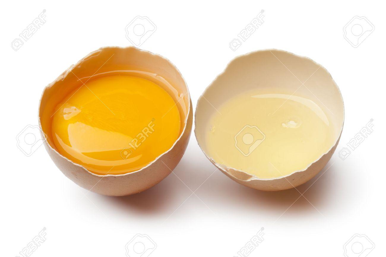 Egg yolk and white in a broken brown egg shell on white background - 38308623
