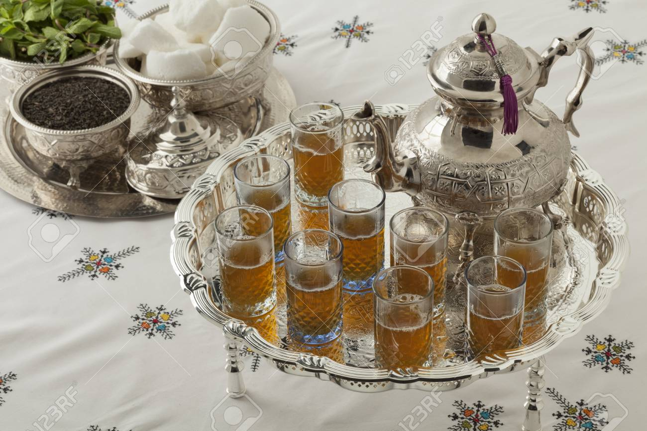 Stock Photo - Traditional festive Moroccan silver tea set and glasses on the table & Traditional Festive Moroccan Silver Tea Set And Glasses On The ...
