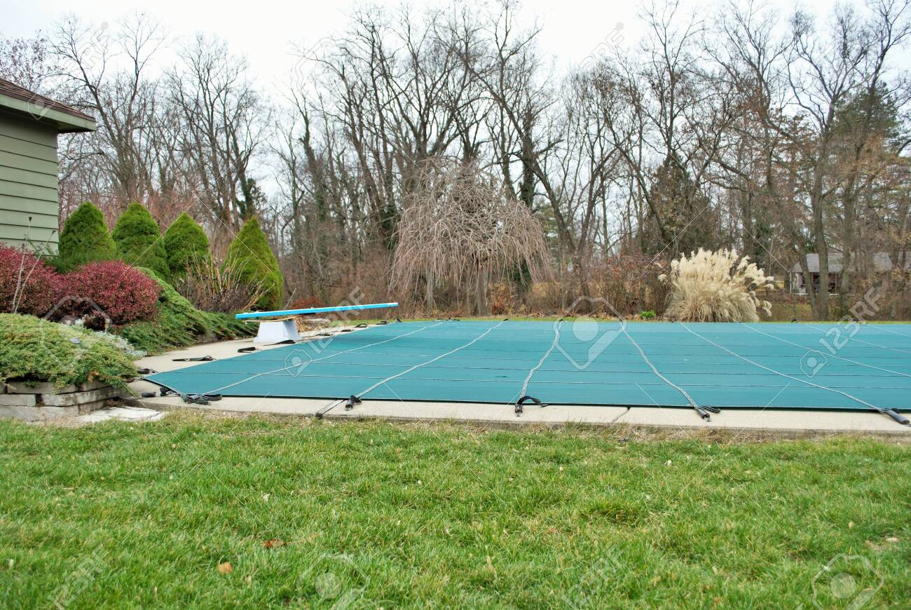 Backyard Swimming Pool With Diving Board And Pool Slide Tarped Stock Photo Picture And Royalty Free Image Image 135441777