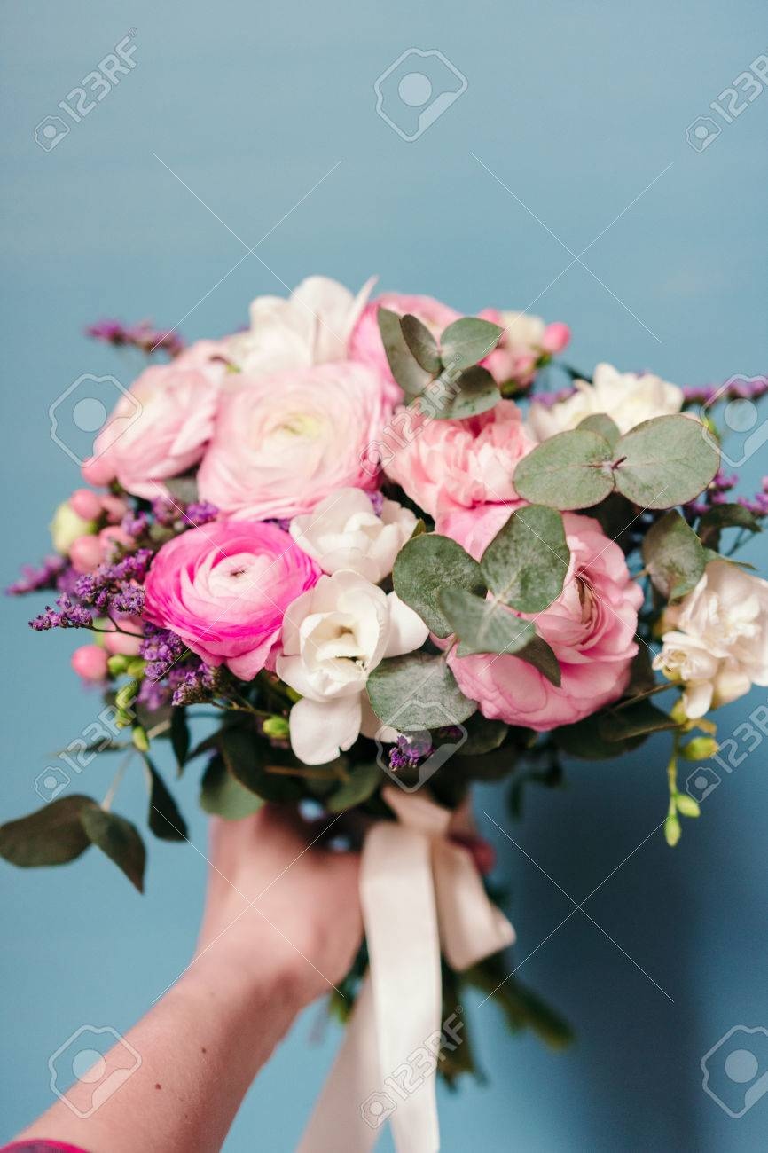 Delicate Wedding Bouquet Of Ranunculus Flower Freesia And Eucalyptus Stock Photo Picture And Royalty Free Image Image 76392311