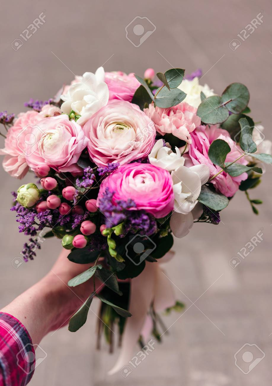 Delicate Wedding Bouquet Of Ranunculus Flower Freesia And Eucalyptus Stock Photo Picture And Royalty Free Image Image 76392323